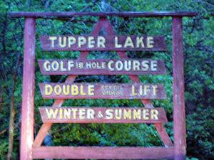 Big Tupper sign on the NW entrance to village on NY 3